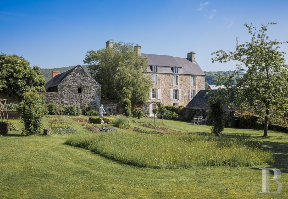 Residences for sale - lower-normandy - A 13th century, large, luxurious home and its outbuildings in a landscape garden, overlooking a valley in the Calvados department in the midst of Swiss Normandy